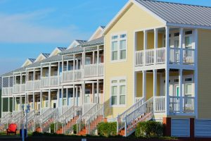 Colorful townhouses with balconies for considering HOA Condo grill rules
