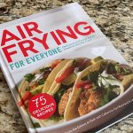 Air Frying for Everyone Cookbook from Dash on a granite kitchen counter